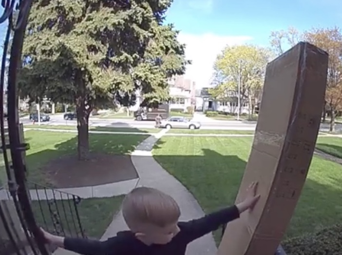 boy holding up package