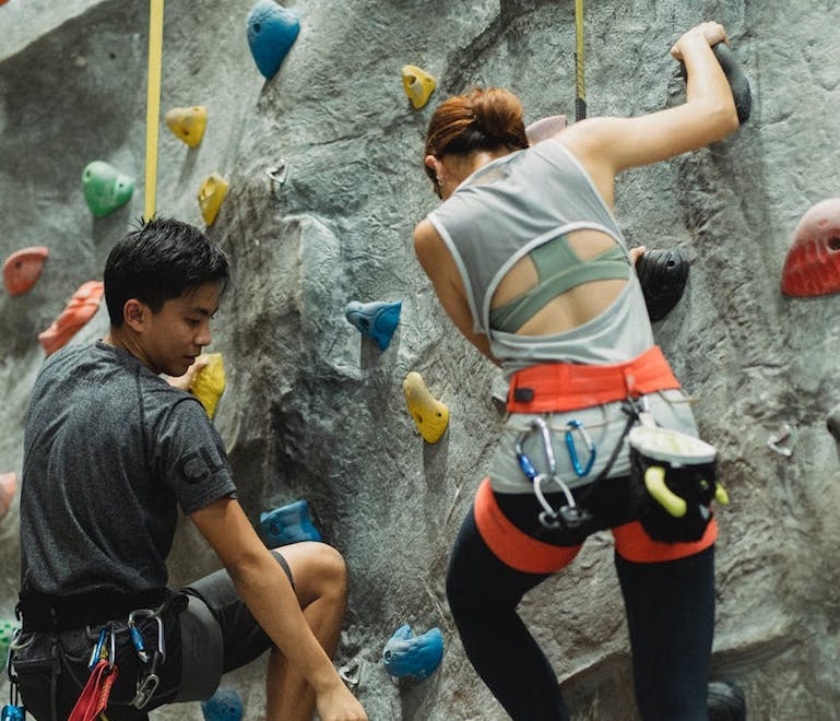 friends rock climbing