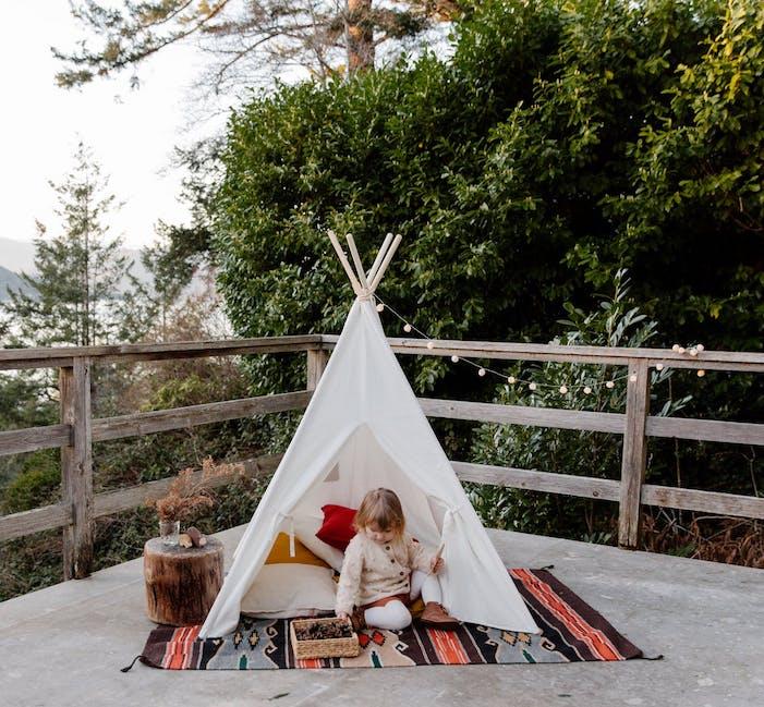 little girl in cute tent