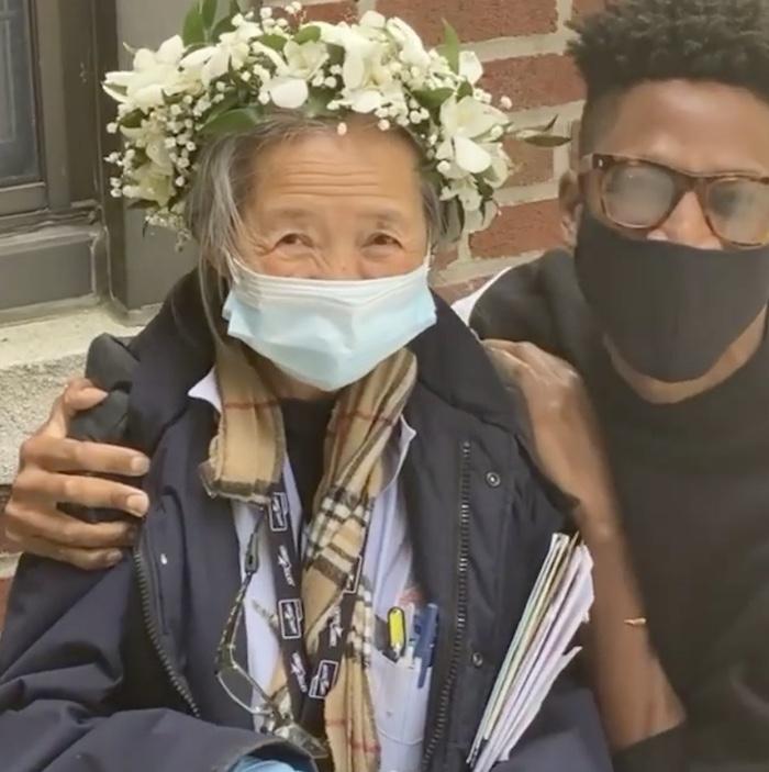 man hugging woman in flower crown