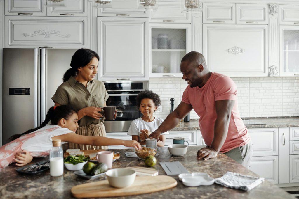 family gathered around kitchen island