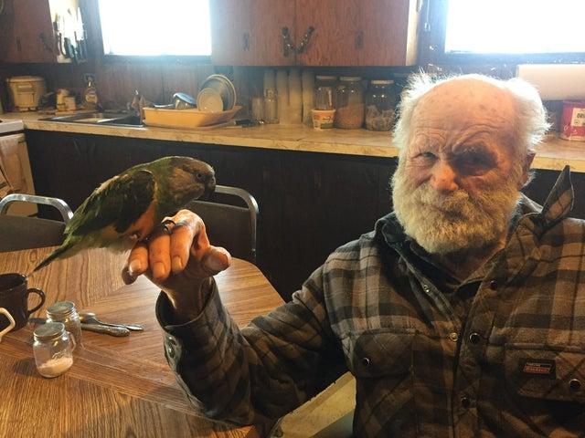 grandpa holding parrot