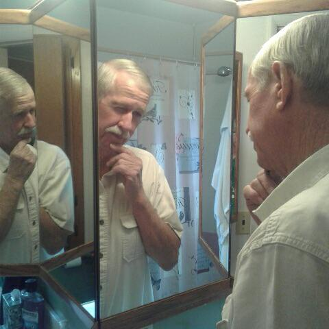 grandpa with two reflections of himself in mirror