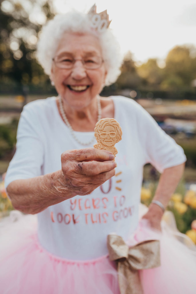 grandma holding a cookie and smiling