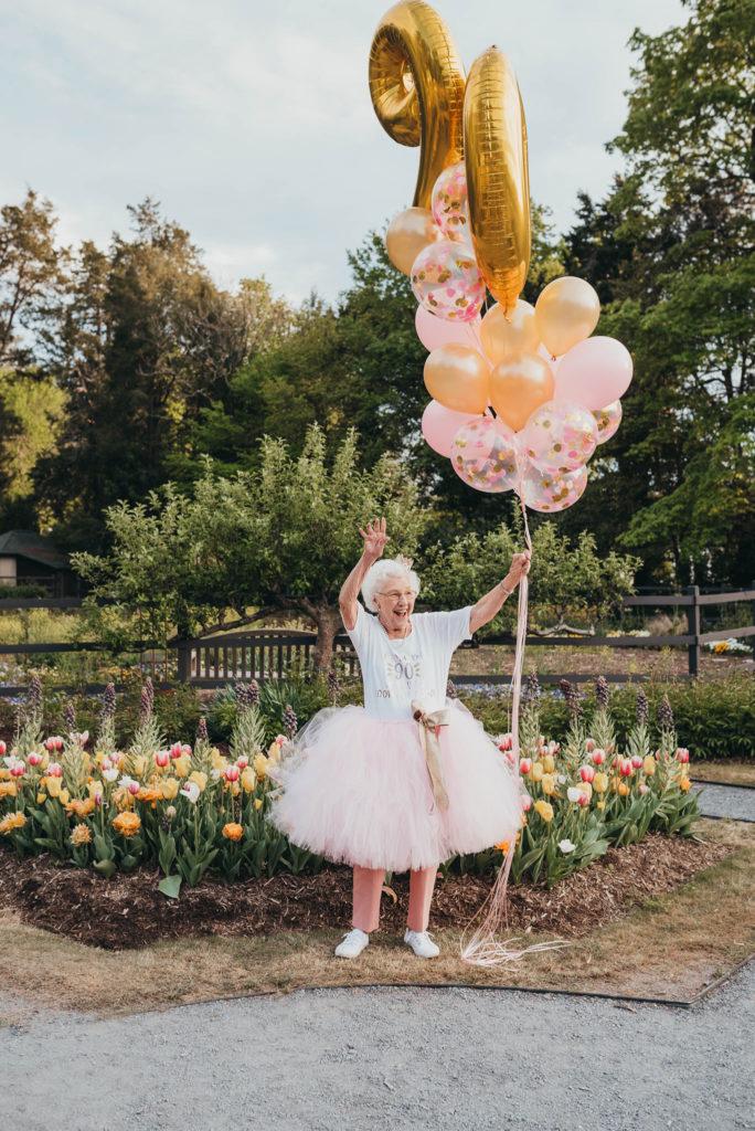 grandma holding balloons