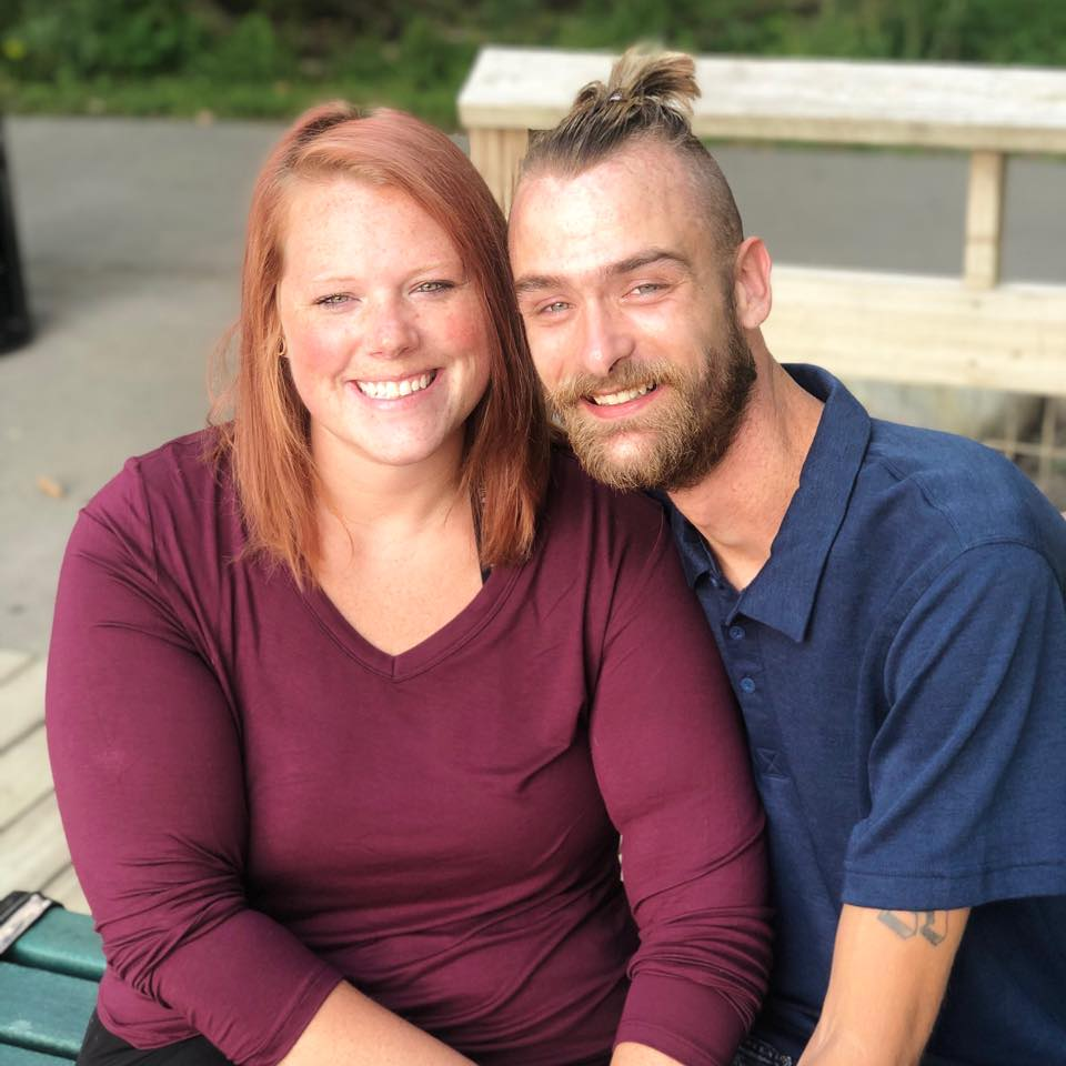 woman and man smiling at camera