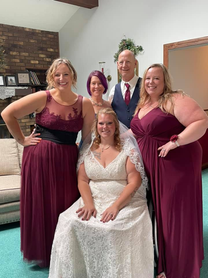 bride with her two sisters and parents