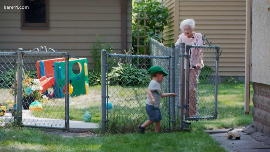little boy walking over to old woman