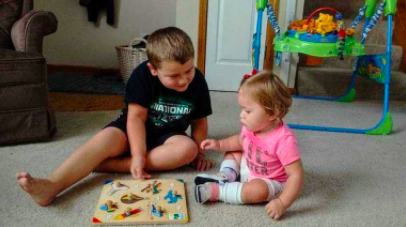 Ivy playing game with her brother