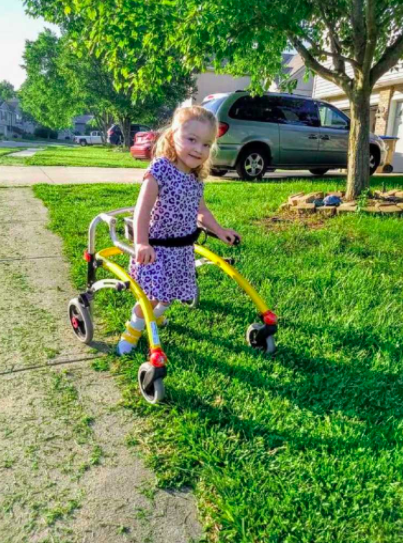 Ivy standing with her walker