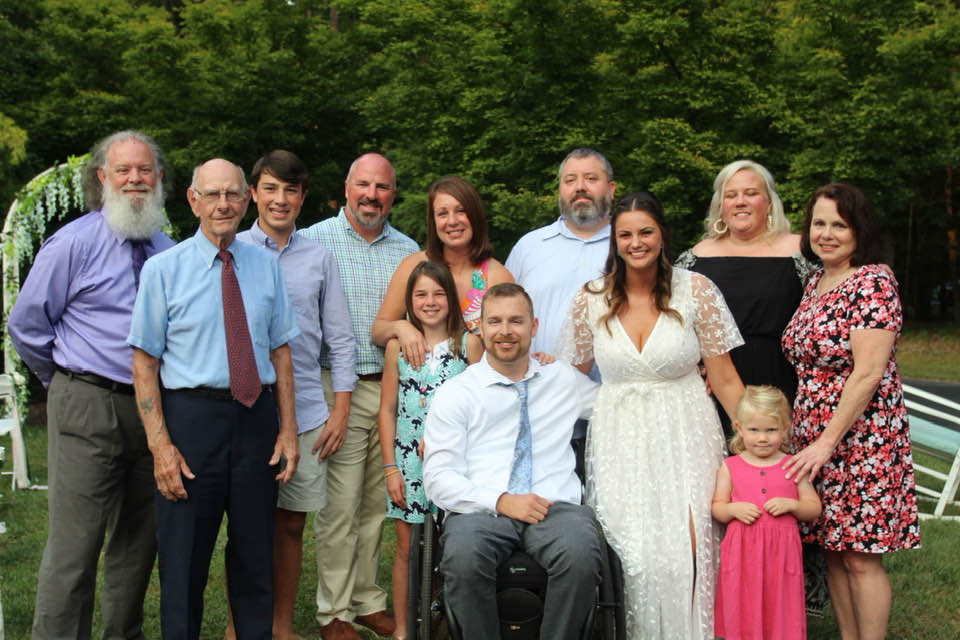 bride and groom with family