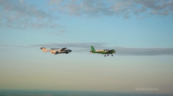 aircar flying behind plane
