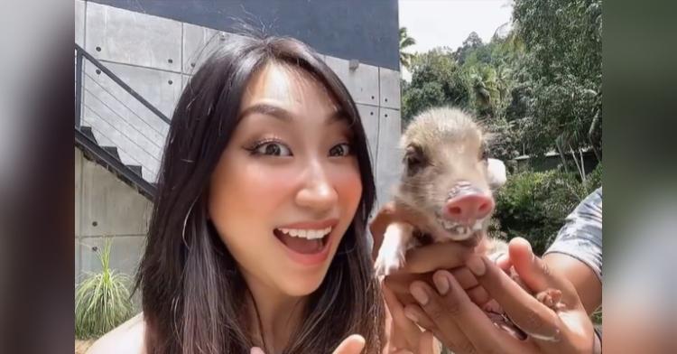 woman holding baby boar