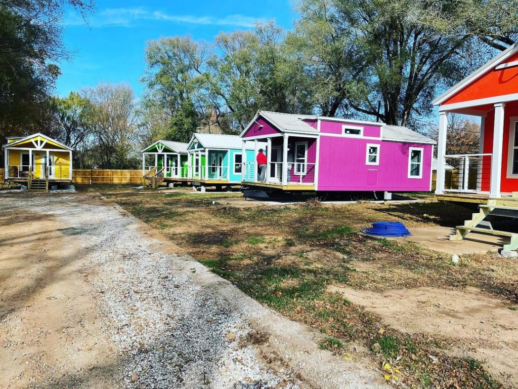 five tiny homes of all different colors