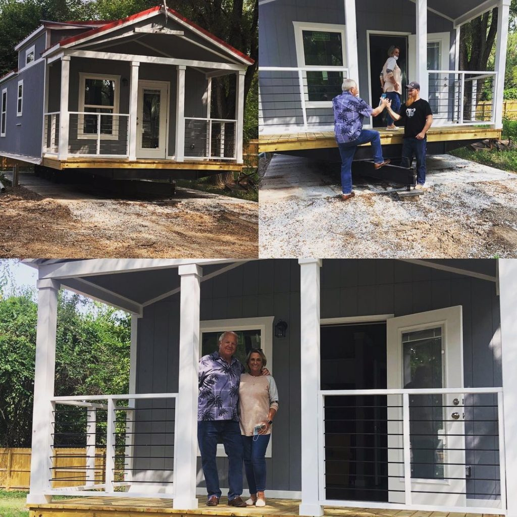 couple standing on porch of tiny home