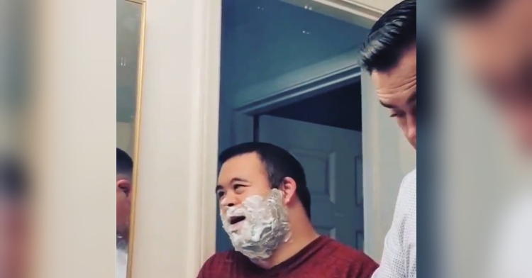 man helps his son shave