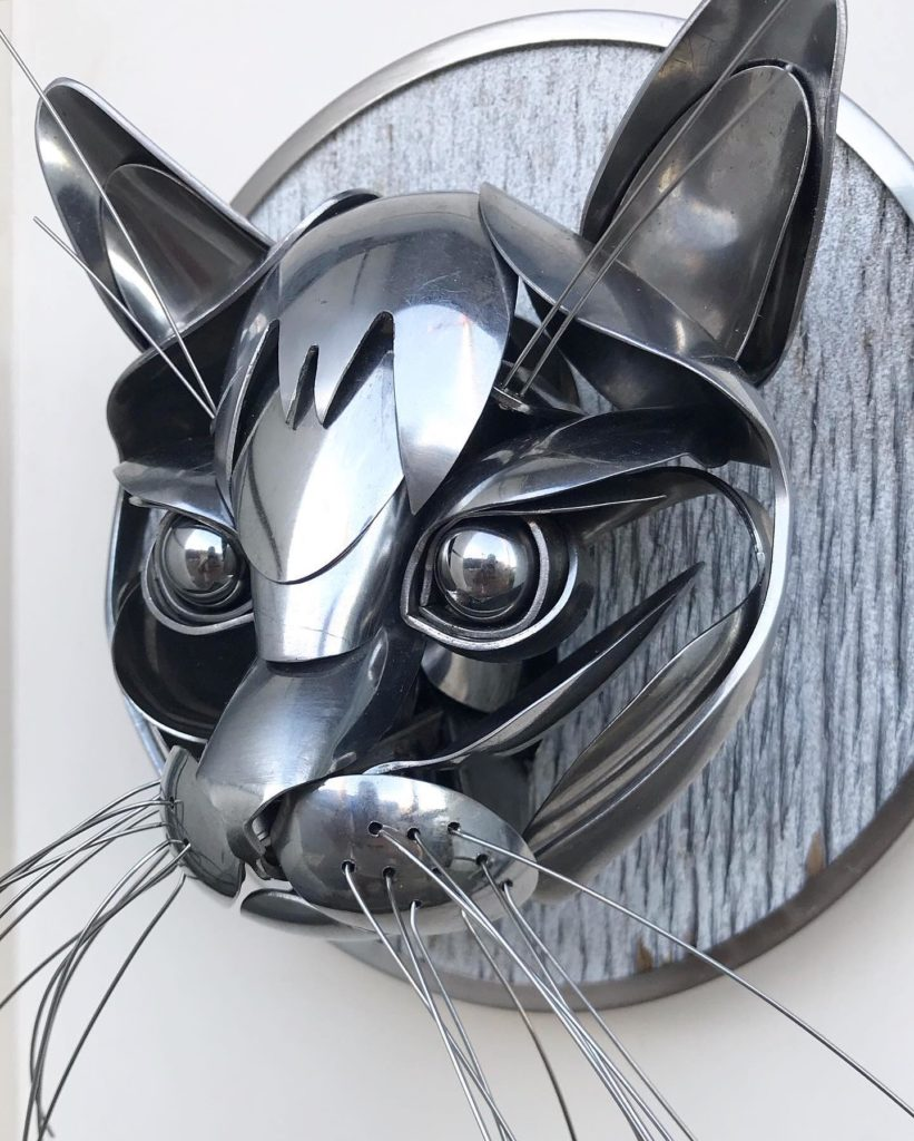 silver cat sculpture