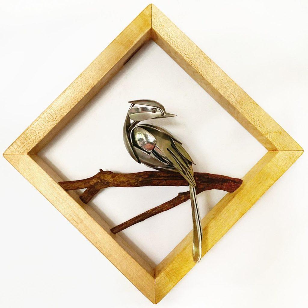 bird sculpture on branch