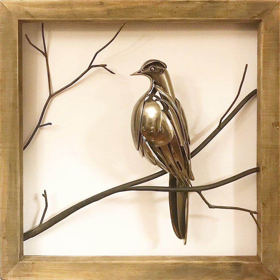 bird sculpture on branches