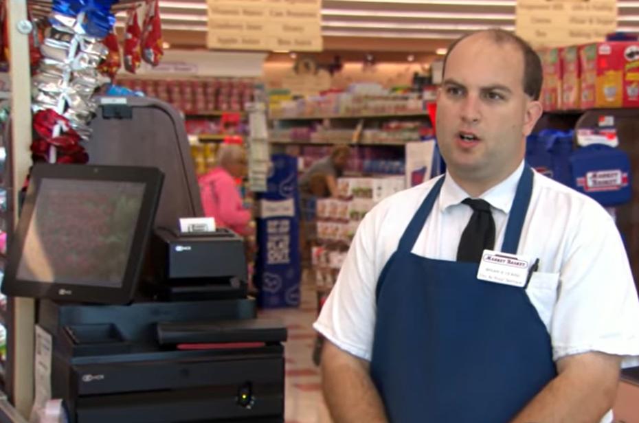 cashier talking at register
