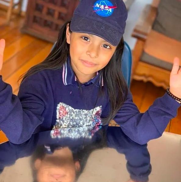 little girl wearing nasa hat