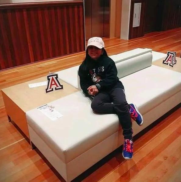 little girl sitting on bench at university of arizona
