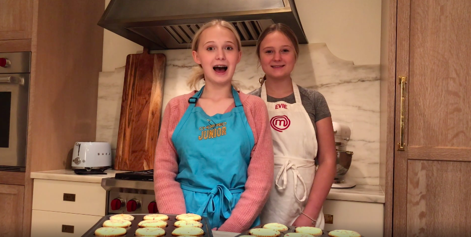 two sisters wearing aprons in kitchen