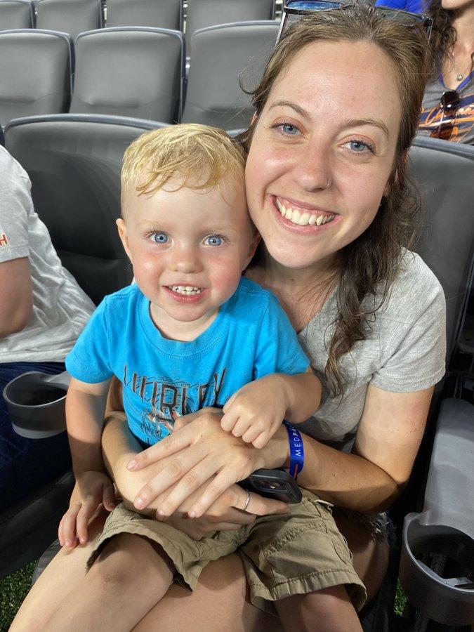 mom holding son in stadium seat