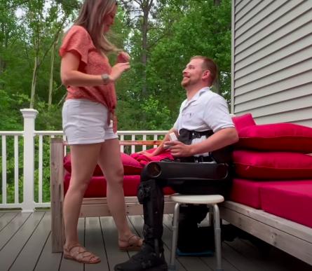 man wearing exoskeleton proposes