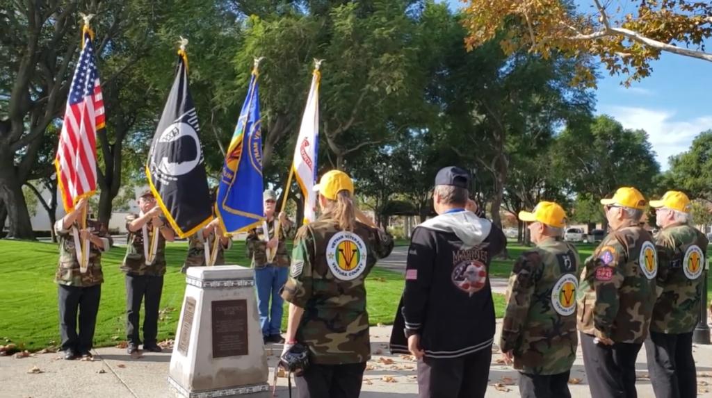 veterans saluting flags
