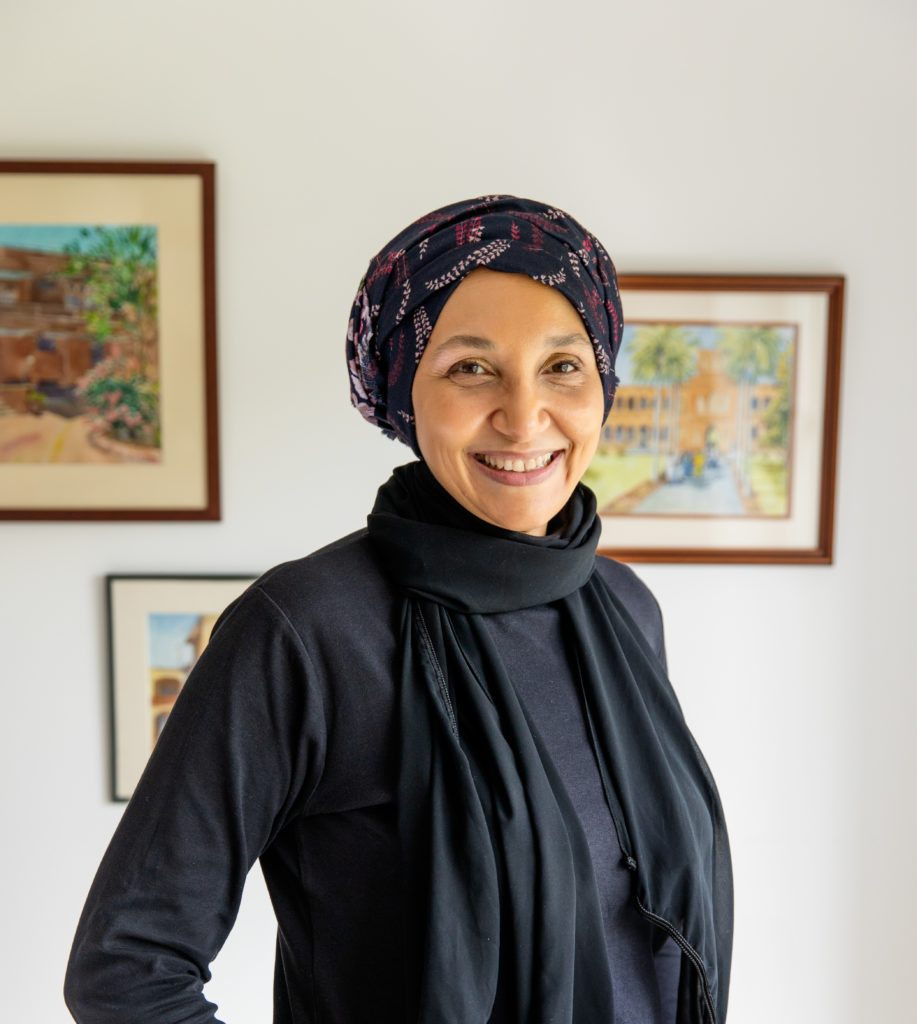 smiling woman wearing head covering