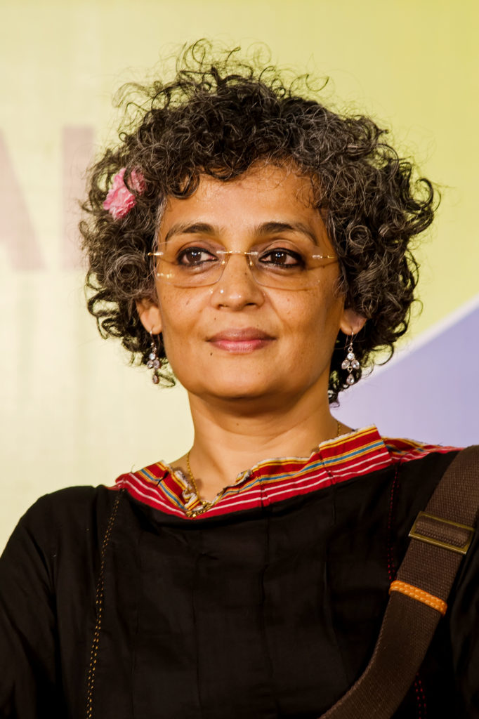 woman with short, curly hair wearing glasses