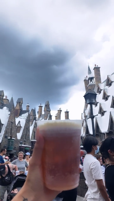 someone holding a butterbeer