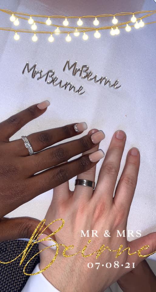 bride and groom's hands wearing wedding rings