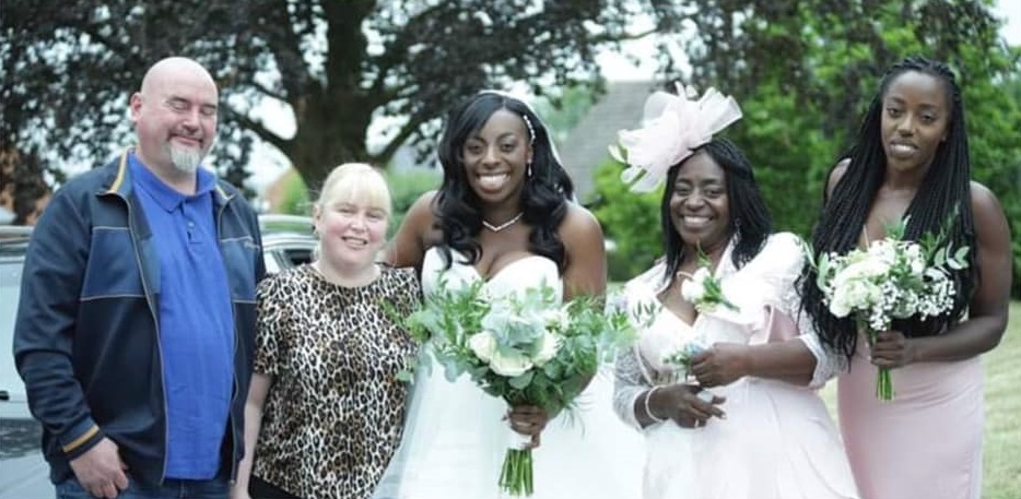 bride standing with couple who drove her to wedding on left and her mom and bridesmaid on right