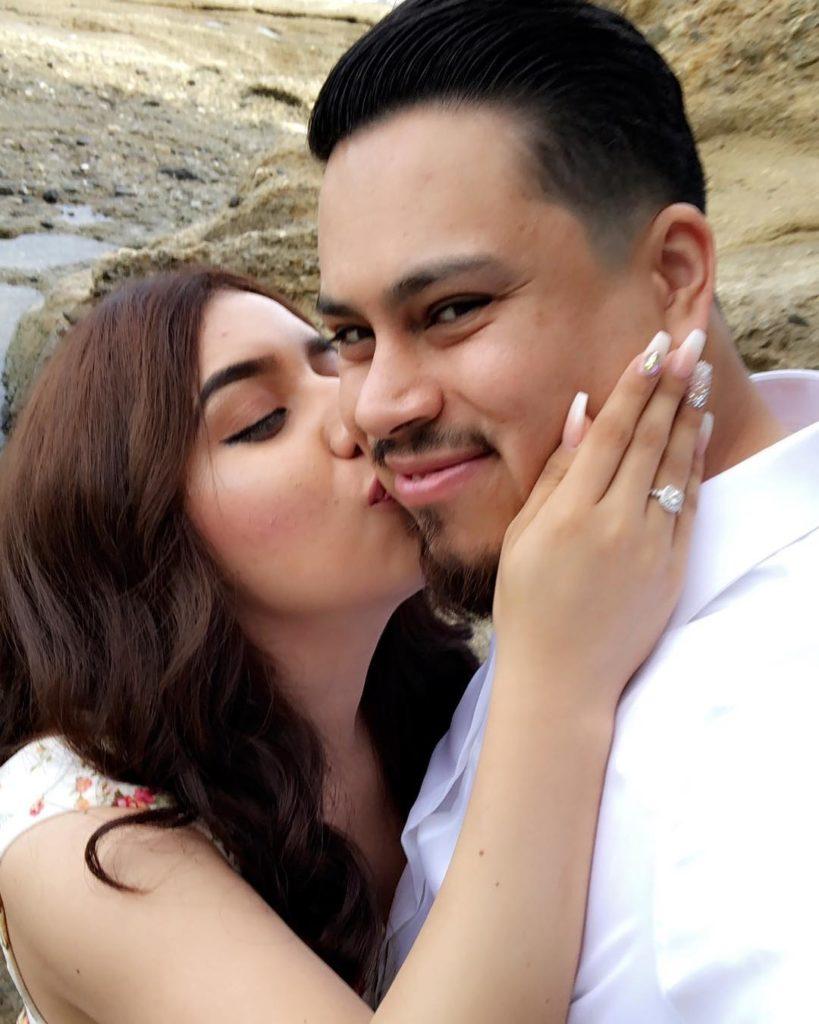 wife kissing husband's cheek