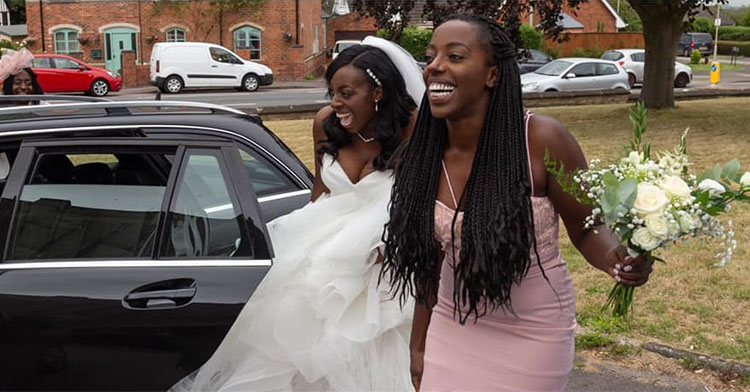 bride and bridesmaid on side of road