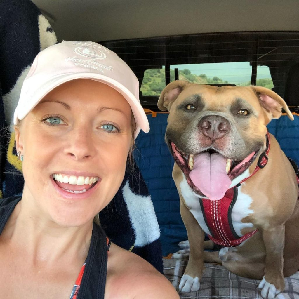 woman with happy pit bull