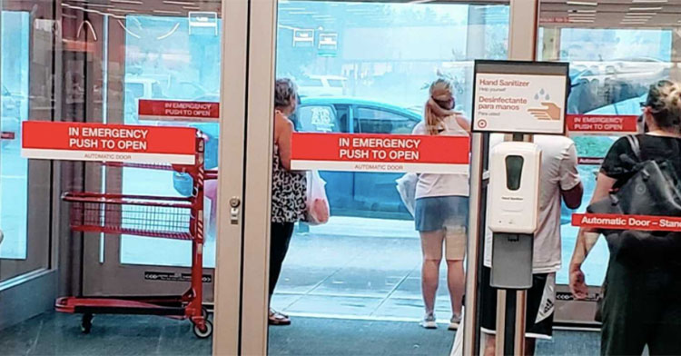 shoppers waiting to leave target while it's pouring rain