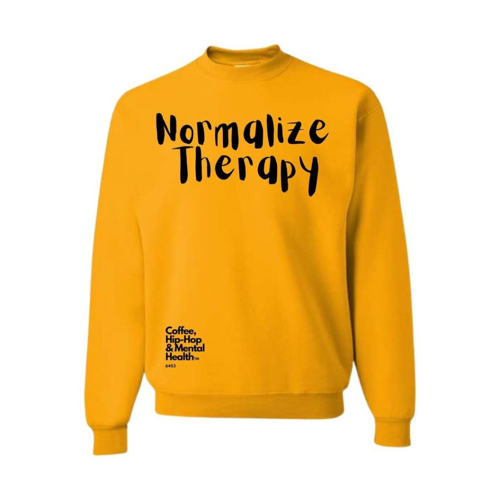 yellow sweatshirt that reads normalize therapy in black letters