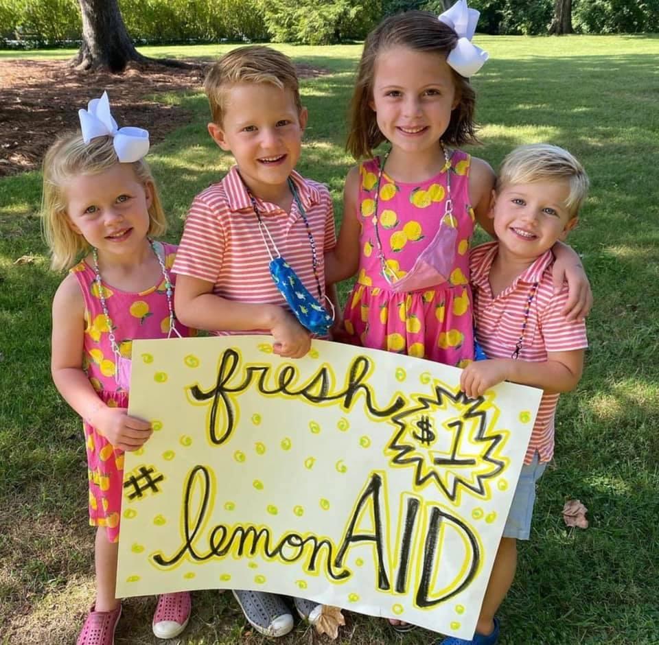 kids holding fresh lemonade sign