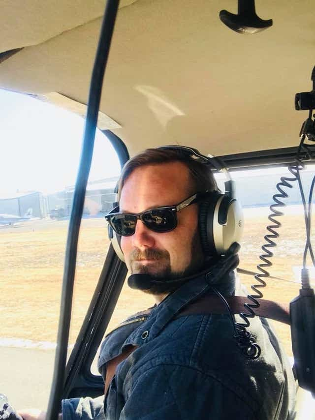 pilot smiling in helicopter cockpit