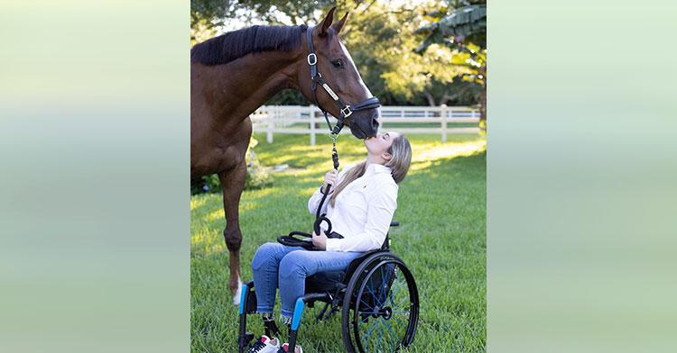 woman in wheelchair kissing horse