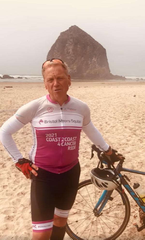 dad holding bike on beach