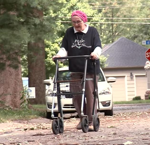 grandma using walker on street