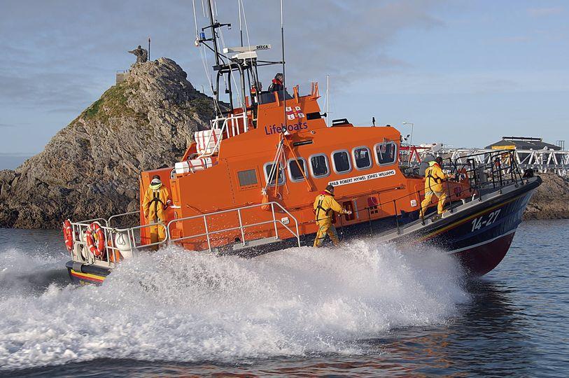 rescue crew on orange Lifeboat