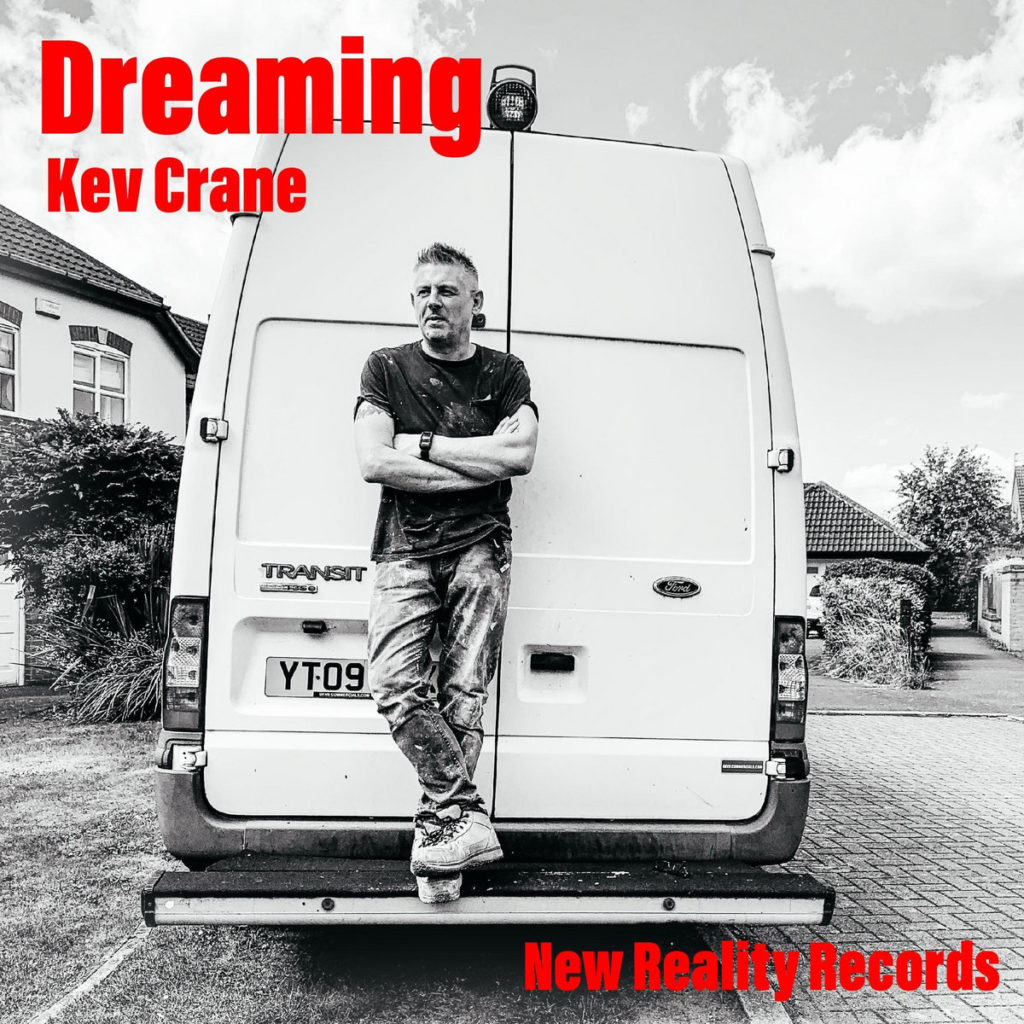 album cover called dreaming with man standing on back bumper of car
