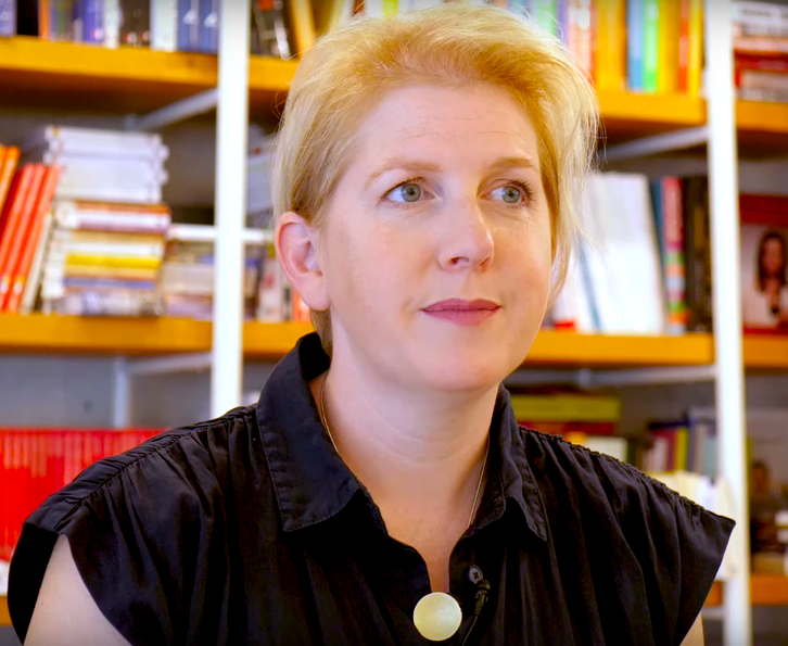 woman giving interview with short blonde hair and black shirt