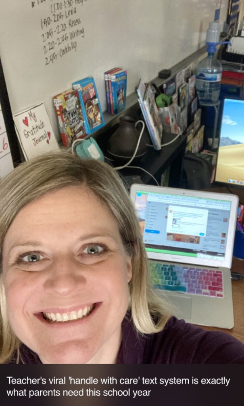 smiling woman with open laptop in the background on a desk