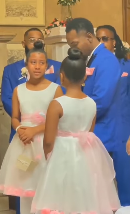 men in blue suits and two little girls in dresses at a wedding